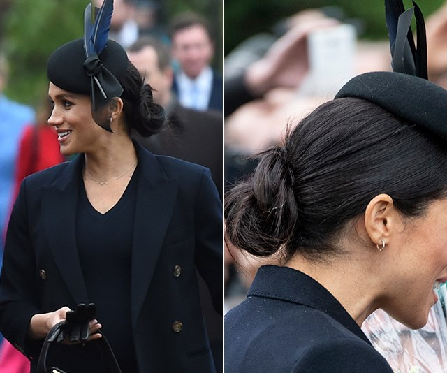 On Christmas Day 2018, Meghan's Philip Treacy hat and low bun paired up to perfection.