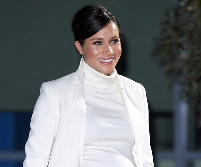 "Out for a [night at the museum](https://www.nowtolove.com.au/royals/british-royal-family/meghan-markle-white-dress-54118|target=""_blank"") a few days earlier, Meghan's high bun was the perfect pairing with her high neckline."