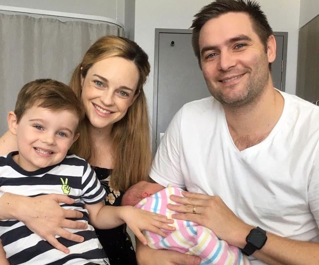 Penny shared a happy family photo with her newborn daughter Neve.