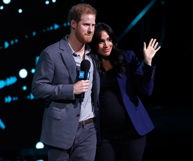 Prince Harry delivered a rousing speech before asking his wife to join him on-stage. *(Image: Getty)*