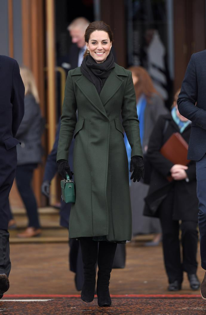 Duchess Catherine was all smiles in her dark green ensemble. *(Image: Getty Images)*