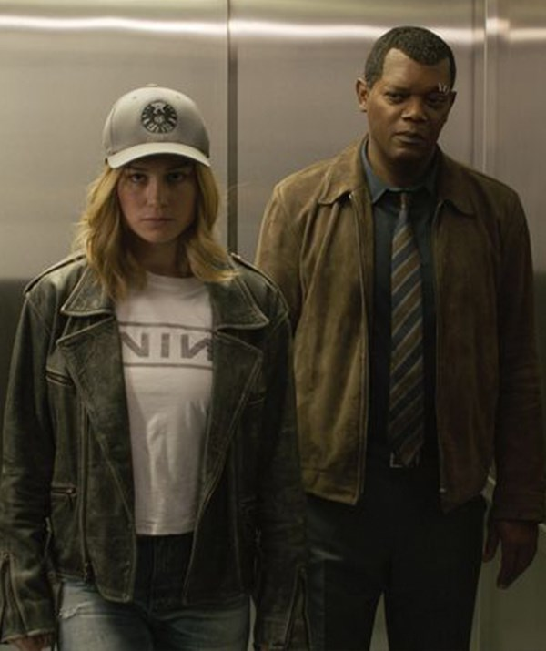 Carol Danvers (Brie Larson) and Nick Fury (Samuel L. Jackson) in *Captain Marvel*.