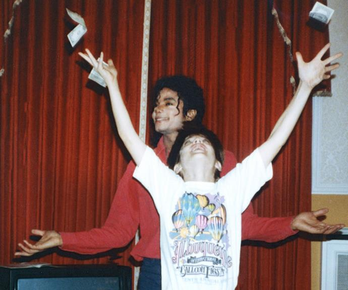 Michael Jackson with one of the young boys he is accused of sexually abusing. *(Image: HBO)*