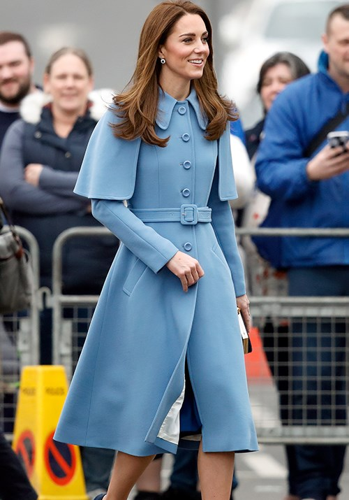 Royal power dressing: Kate's Mulberry blue capelet coat is nothing short of dreamy. *(Image: Getty)*