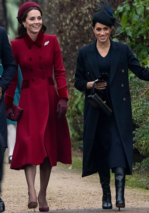 Kate and Meghan *know* how to rock a chic coat. *(Image: Getty)*