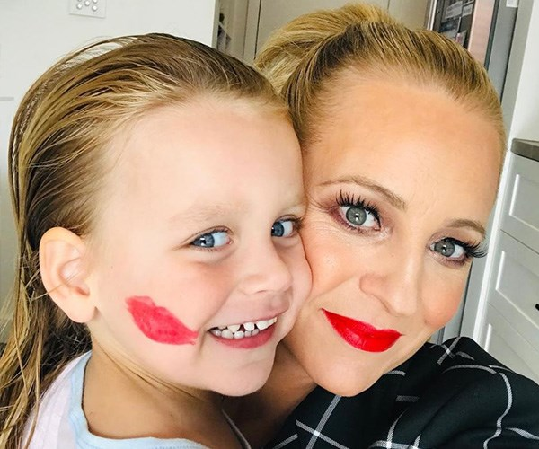 Carrie and Evie donned the perfect power red lippy for International Women's Day. *(Image: Instagram @bickmorecarrie)*