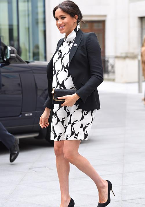 Looking stunning in a monochrome printed shift dress by REISS, a black blazer by Alexander McQueen and  Manolo Blahnik heels, the Duchess looked ready to take on the world - despite being only weeks out from giving birth! *(Image: Getty Images)*