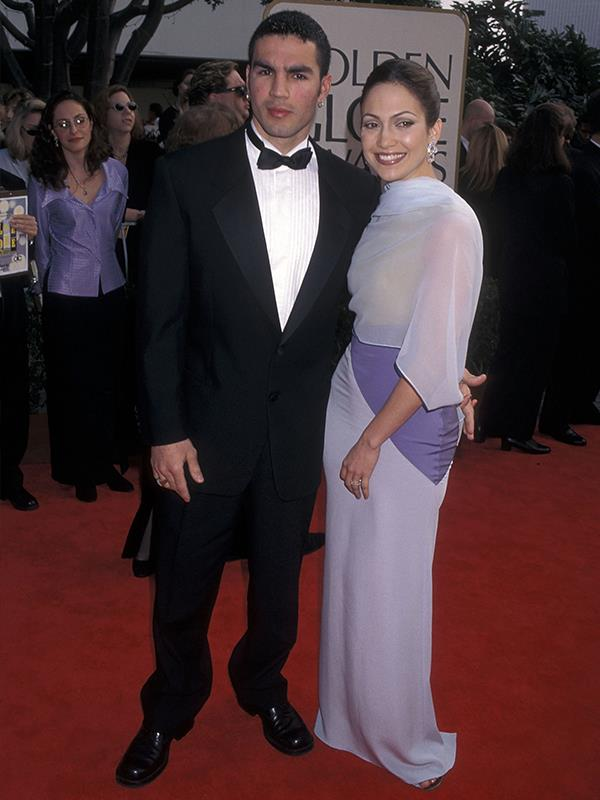 The two fell madly in love before Jen got her big break in the 1997 biopic hit *Selena*, but divorced soon after. In 2006, JLo even sued Ojani to stop him from publishing a tell-all book about their marriage and releasing a sex tape from their honeymoon. *(Image: Getty Images)*