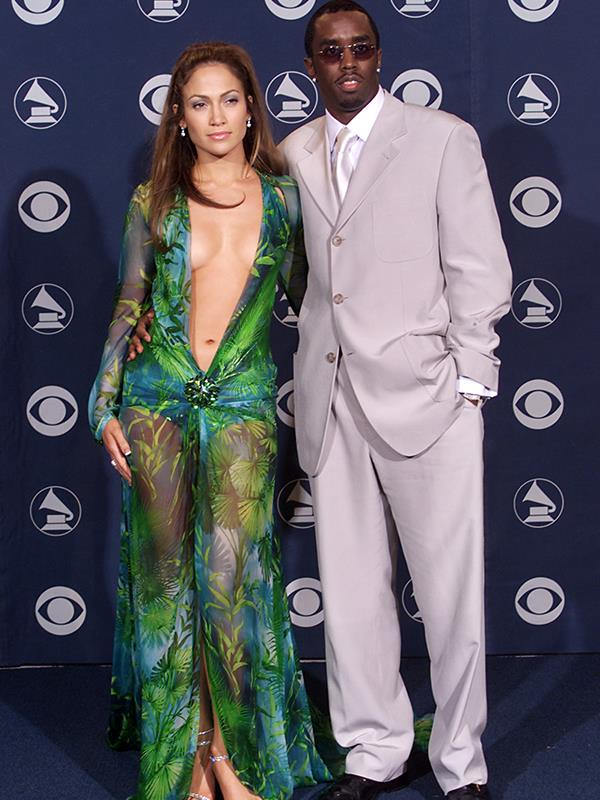 Who could forget this outfit? Jennifer's iconic Versace gown was accessorised by her high-profile boyfriend Sean Combs back when he was Puff Daddy. The couple dated from 1999-2001 but had their fair share of drama. Both were charged in connection with a Manhattan nightclub shooting, though charges against JLo were quickly dropped after questioning. *(Image: Getty Images)*