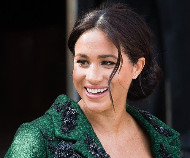 And with her hair in her signature up-do, this might be one of our favourite maternity looks on the royal yet. *(Image: Getty Images)*