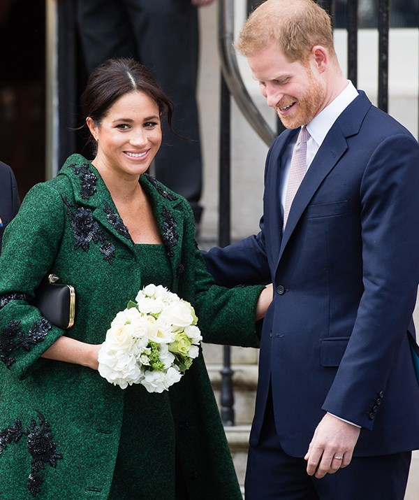 The heavily pregnant yet oh-so-stylish royal paired the stunning embellished coat with her Givenchy purse and Aquazzura bow pumps. *(Image: Getty Images)*