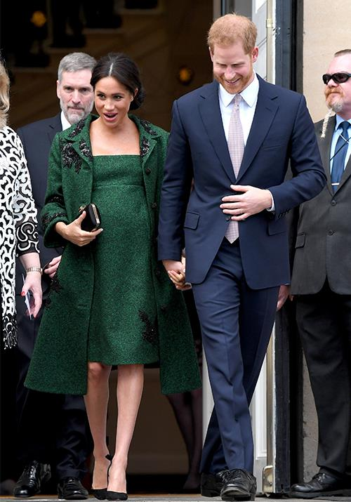 "A vision in green! Meghan stepped out on [Commonwealth Day](https://www.nowtolove.com.au/royals/british-royal-family/kate-middleton-meghan-markle-commonwealth-day-54581|target=""_blank"") (March 11) with husband Prince Harry to attend celebrations at Canada House.  <br><br> Meghan's stunning green Erdem coat and empire-waist dress provided all the winter outfit inspiration we need! *(Image: Getty Images)*"