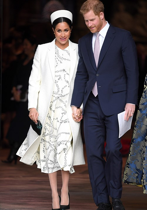 Outfit change! Later in the day, Meghan stepped out for a second time at the Commonwealth Day service at Westminster Abbey. <br><br> Meghan wore a Victoria Beckham coat and dress paired with a pillbox hat and olive green heels.  *(Image: Getty Images)*