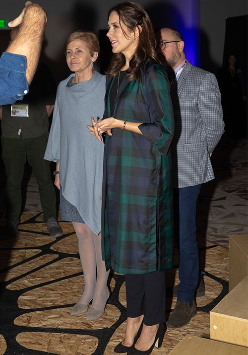 **March 2019, Texas** <br><br> While on an official royal visit to Texas, Crown Princess Mary wore a trendy green and black tartan coat - not unlike similar tartan styles worn by Duchesses Meghan and Catherine in the past!   *(Image: Getty)*