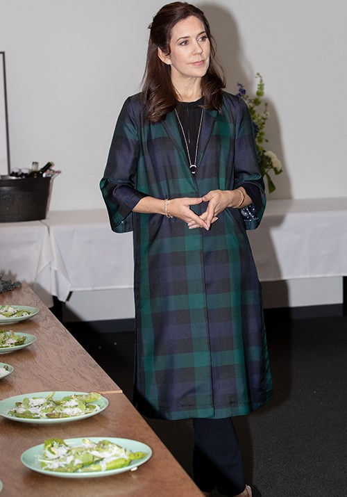 The royal paired the jacket with a black jumper and trousers, as well as a striking long pendant necklace.  *(Image: Getty)*