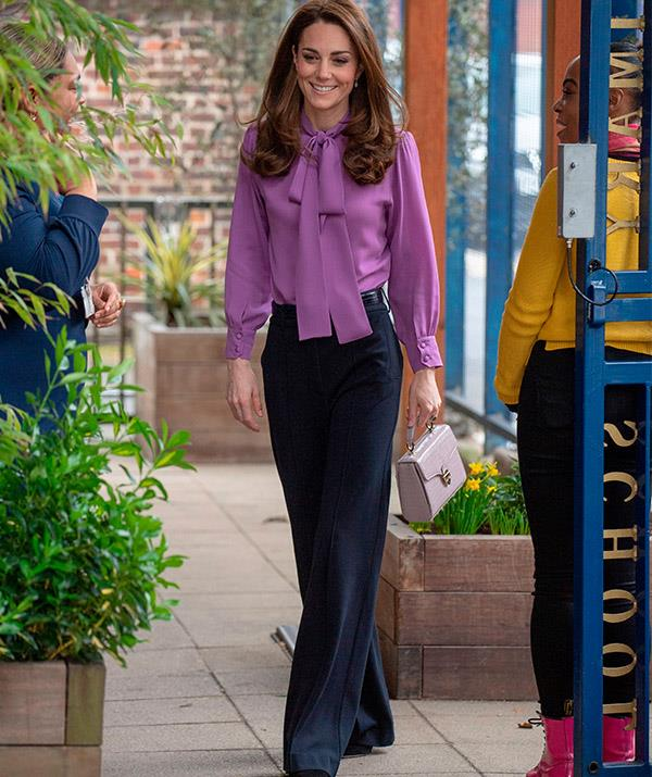 The Duchess accessorised her trendy ensemble with a lilac handbag.  *(Image: Getty)*