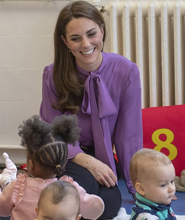 A mum-to-three, Kate looked at home with the children at the centre. *(Image: Getty)*