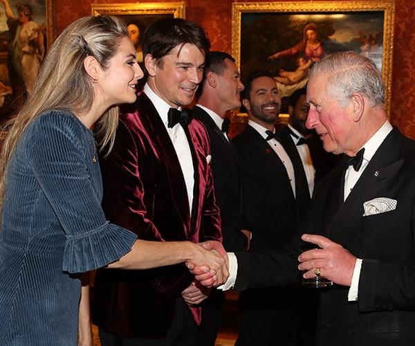 The *St Trinians* star was all smiles as she shook hands with the Prince of Wales.