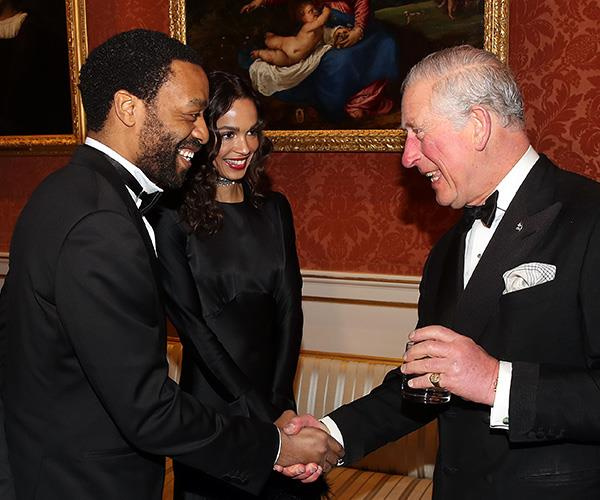 *12 Years A Slave* actor Chiwetel Ejiofor shakes hands with Prince Charles.