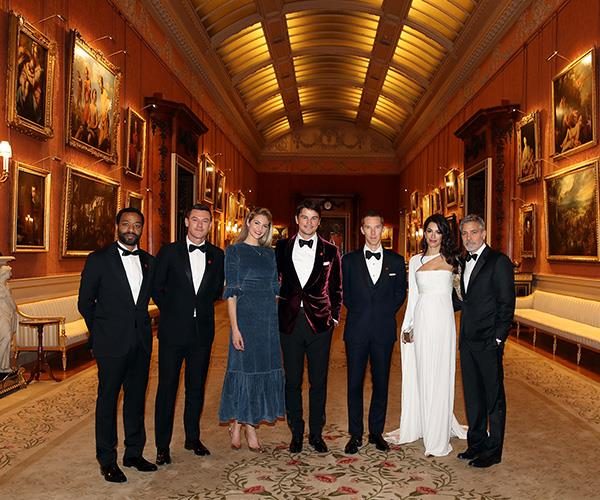The A-list guests pose for a photograph in Buckingham Palace.