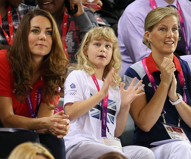 Kate, Lady Louise and Sophie cheer on the Brits at the 2012 London Paralympic Games. *(Image: Getty)*