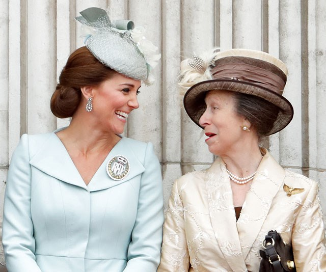 Duchess Catherine and Princess Anne share a right royal laugh during celebrations for the centenary of the RAF on the balcony of Buckingham Palace in 2018. *(Image: Getty)*