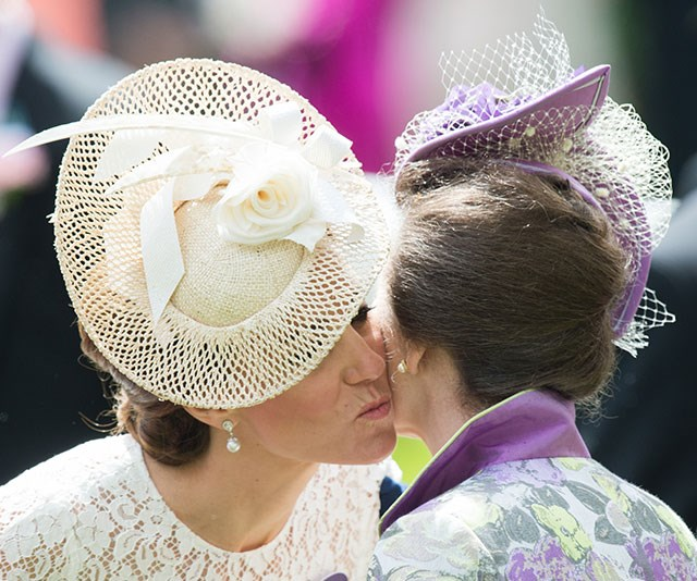 Kate greets Anne with a warm kiss at Royal Ascot in 2016. *(Image: Getty)*