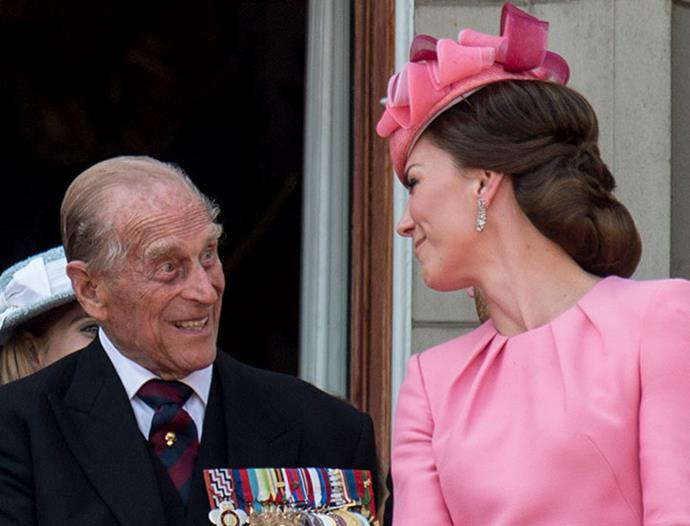 He's known for having a stiff-upper lip but it looks like granddaughter-in-law Duchess Catherine knows how to make Prince Philip chuckle. *(Image: Getty)*