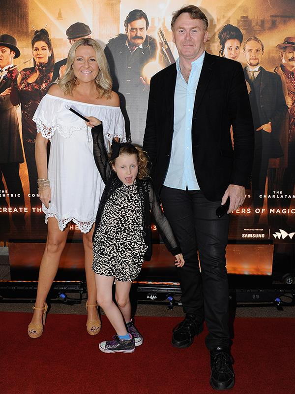Angela with husband Peter Baikie and daughter Amelia in 2015. *(Image: Getty Images)*