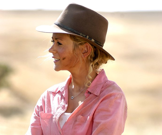 """**Then: Rachael Carpani** <br><br> Jodi Fountain was Jack McLeod's secret daughter and farmhand of Drover's Run. A romance and short-lived marriage to Alberto, and a shocking paternal discovery were some of her major moments, though they paled in comparison to Jodi's death. She was """"killed"""" in a car explosion so she could enter the Witness Protection Program with Matt."""
