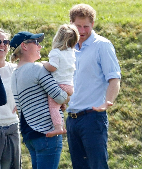 Zara's daughter Mia plays with the prince at the polo. *(Image: Getty)*