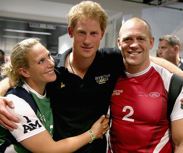 Lending their support to a worthy cause: Zara and her husband Mike Tindall joined Harry for a display game of wheelchair rugby when he first launched the Invictus Games in 2014. *(Image: Getty)*