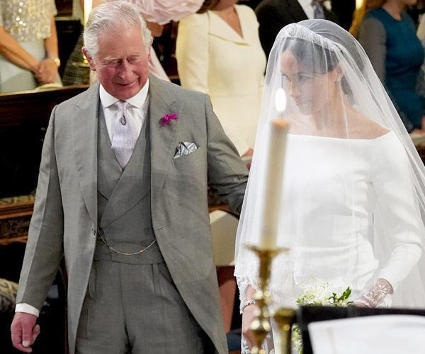 Who could forget when Prince Charles walked Meghan down the aisle? *(Image: Getty)*