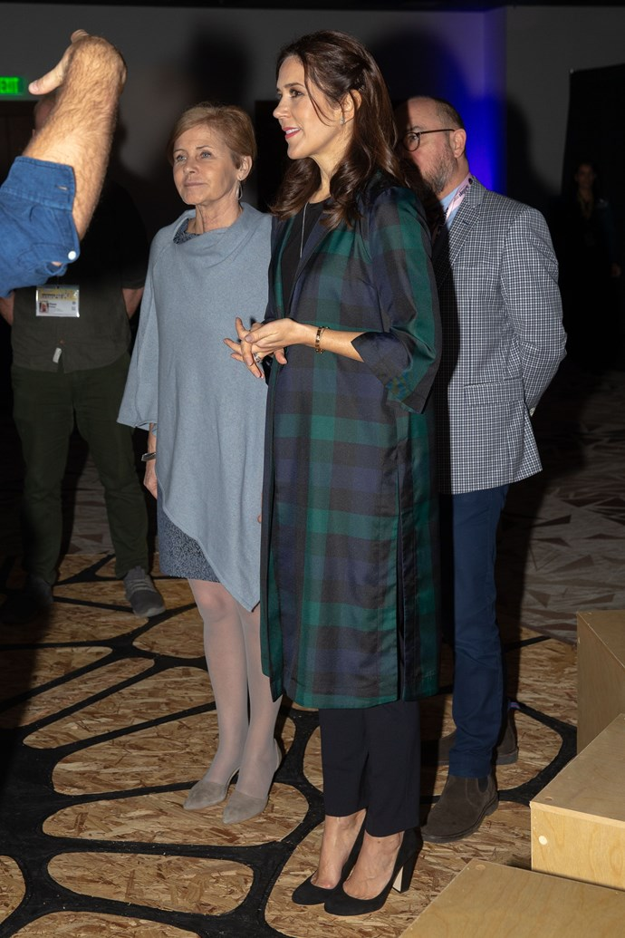 """Mary accessorised her look with a pair of black heels and a long pendant necklace, leaving her [brunette tresses](https://www.nowtolove.com.au/royals/international-royals/princess-mary-hair-53009