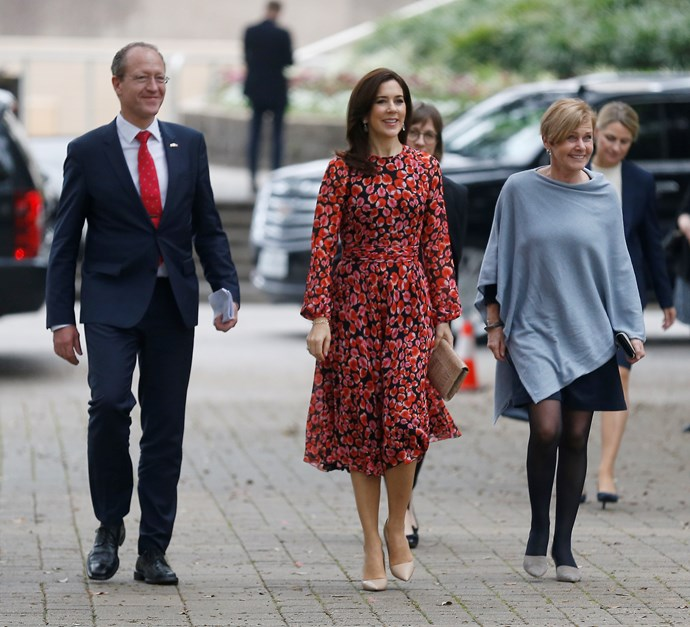 On day two of her trip, Mary stepped out in a stunning red printed frock as she visited the Houston City Hall to meet Mayor Sylvester Turner. Her nude heels and sleek blow out finished off her look to perfection. *(Image: Getty)*