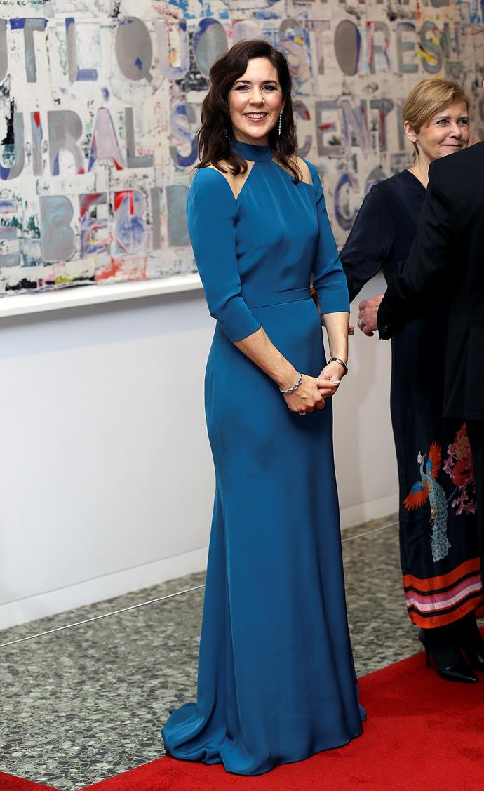 And now for the main event! Princess Mary stunned in a divine blue gown as she attended a Gala Dinner at the Museum of Fine Arts. Featuring flattering silk fabric with shoulder cut-outs, this might be our favourite look of all time on the former Tasmanian beauty. *(Image: Getty)*