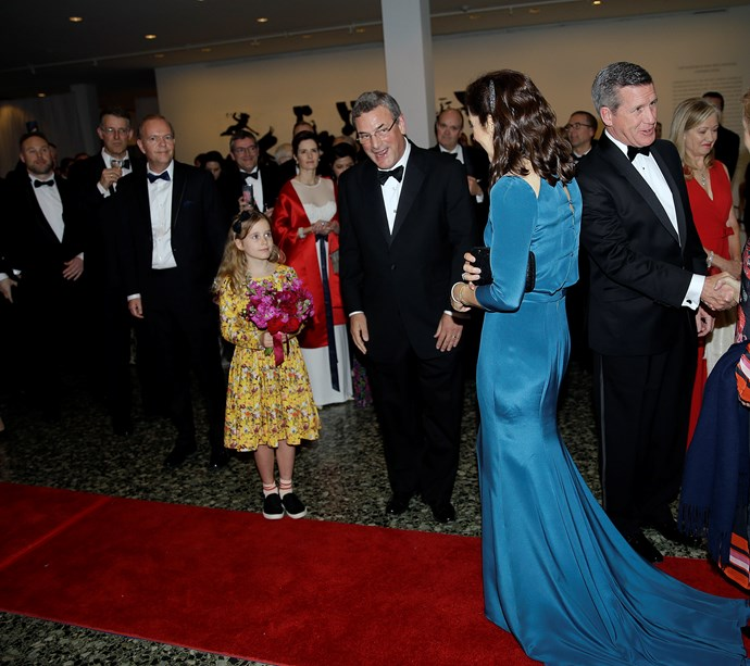 Wearing  her hair in loose waves, the back of Mary's dress was just as exciting as the front, with beautiful  button detailing. *(Image: Getty)*