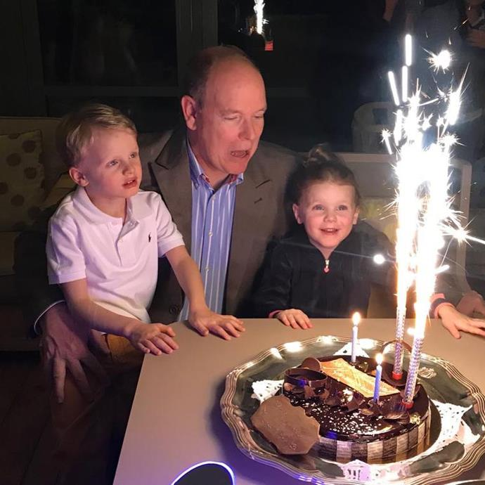 Too cute! Helping Dad blow out his candles. *(Image: @hshprincesscharlene Instagram)*