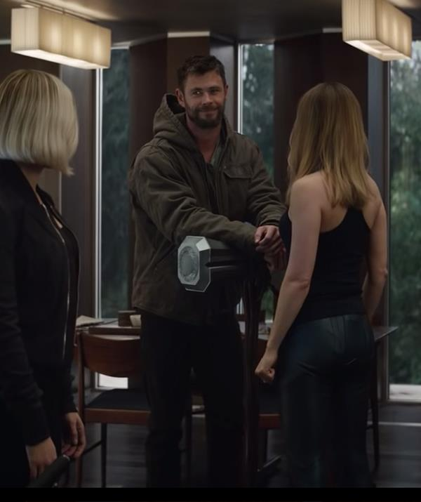 Thor (Chris Hemsworth) holds court with Black Widow (Scarlett Johansson) and Captain Marvel (Brie Larson) in the *Avengers: Endgame* trailer.