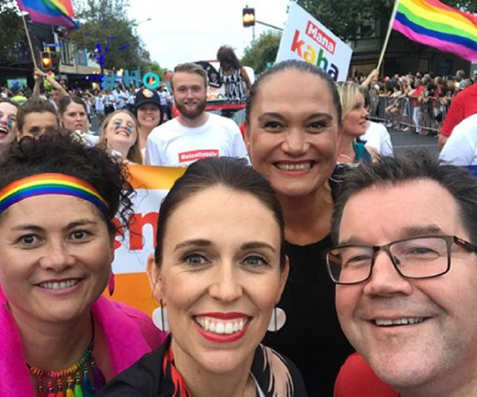 """In February 2018, Ardern became the first New Zealand Prime Minister to march in a gay pride parade. She joined a crowd of 25,000 in support of LGBTI people with mental health problems, posting the above photo to her Instagram page.  <br><br> """"I've loved every Pride Parade I have been lucky enough to walk in, but this one was particularly special. The streets were packed, and what an important message that sends about diversity and inclusiveness,"""" she wrote. *(Image: Instagram @jacindaardern)*"""