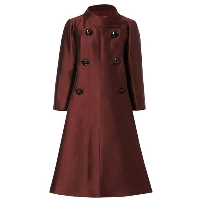 """The stunning vintage Dior coat was the perfect style for heavily pregnant Meghan - and similar to her Courreges coat she was seen wearing in New York (pictured below). *(Image: [1stDibs](https://www.1stdibs.com/fashion/clothing/coats-outerwear/dior-unlabelled-haute-couture-evening-silk-brown-coat-1950/id-v_5786182/