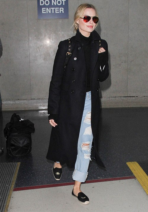 Margot just decided exactly what we'll be wearing next time we fly. *(Image: Getty)*
