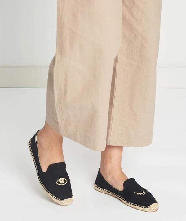 "Get Margot's look with these Solados Wink Embroidery Slippers, $119.95. Available [here](https://www.theiconic.com.au/wink-embroidery-slippers-777590.html|target=""_blank""