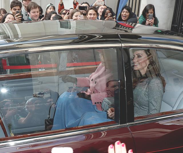 Royally rugged up! Duchess Catherine and Queen Elizabeth shared a blanket as they arrived at King's College. *(Image: Getty)*