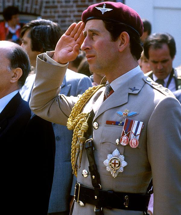 Charles shows a sign of salute during a visit to Bruneval in Normandy, France, to officially open a war memorial in 1982.