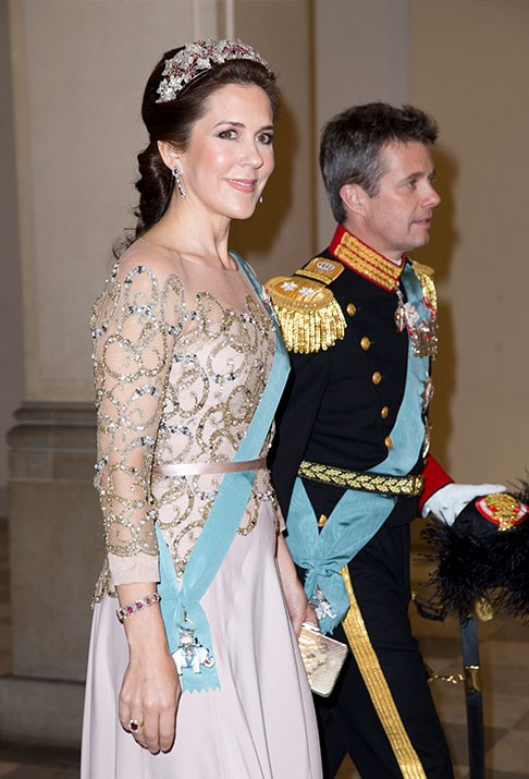 Mary and Fred make a glittering appearance at a dinner for Queen Margrethe's birthday in 2015.