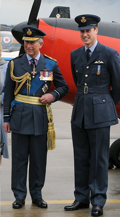 Like father, like son. Prince Charles and Prince William pose for a happy snap in front of the original Chipmonk aircraft which Prince Charles flew when he was training at RAF Cranwell on the day of Prince William's RAF graduation ceremony.