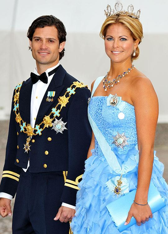 A beardless Prince Carl decked to the nines in all his shiny finery alongside sister Princess Madeleine of Sweden for their older sister Crown Princess Victoria of Sweden's wedding in 2010.