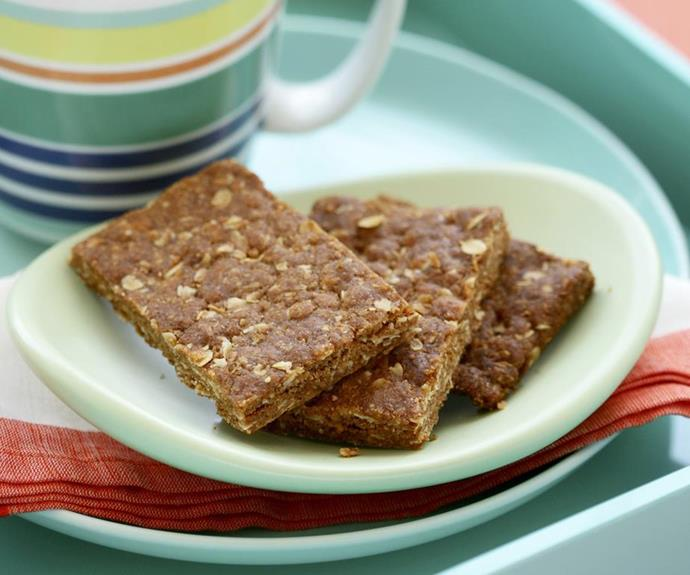 "**Chewy Anzac biscuit slice** <br><br> Enjoy the delicious butterscotch flavours of the Anzac biscuit in chewy slice form. <br><br> See the full *Australian Women's Weekly* recipe [here](https://www.womensweeklyfood.com.au/recipes/anzac-slice-12265|target=""_blank"")."