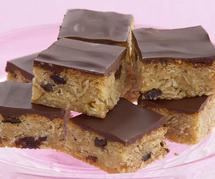 "**Chocolate and raisin Anzac slices** <br><br> This tasty fruity and chocolatey slice takes all the flavours of a traditional Anzac biscuit and turns them into a sweet slice, perfect for work and school snacks. <br><br> See the full *Australian Women's Weekly* recipe [here](https://www.womensweeklyfood.com.au/recipes/chocolate-and-raisin-anzac-slices-19469|target=""_blank"")."